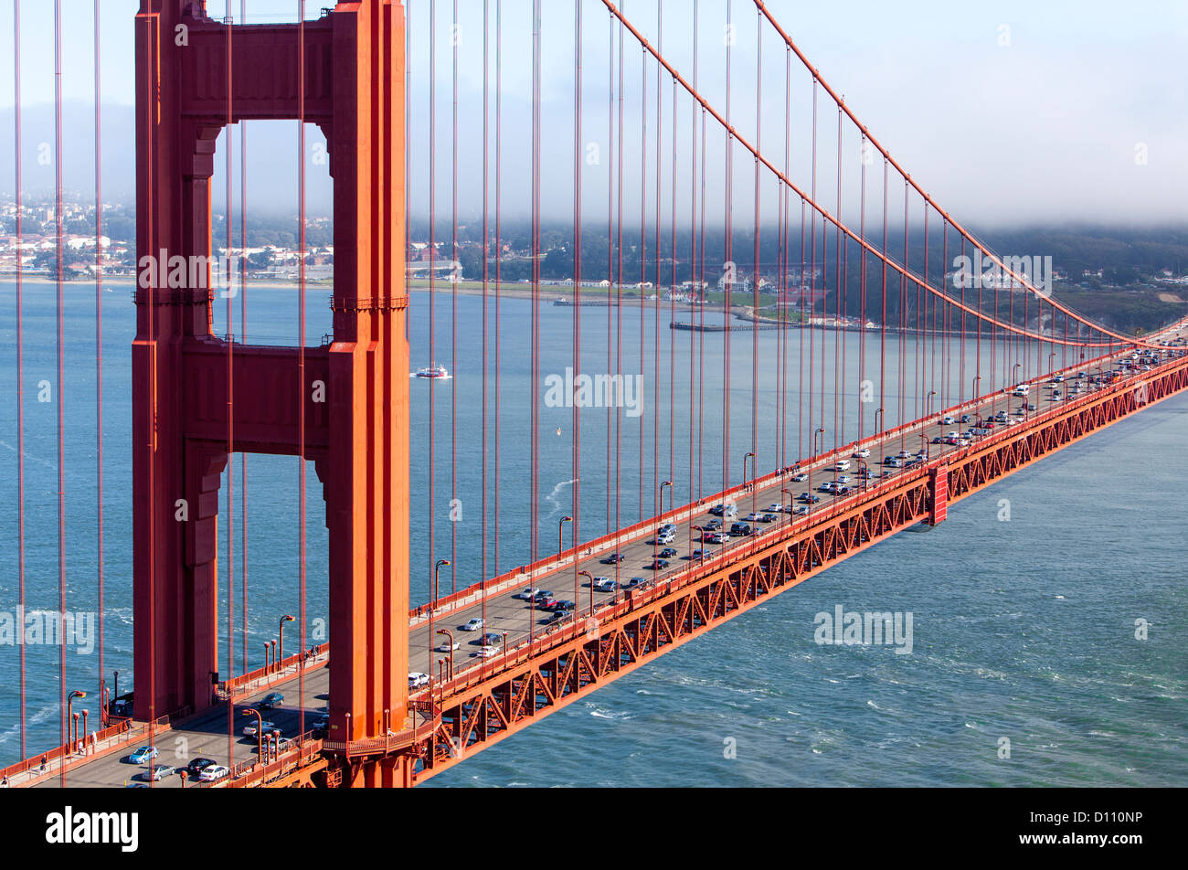The San Francisco Golden Gate Bridge Pedestrians Walking Across The Bridge Cars Driving Across And Boats Sailing In The Bay Stock Photo Alamy