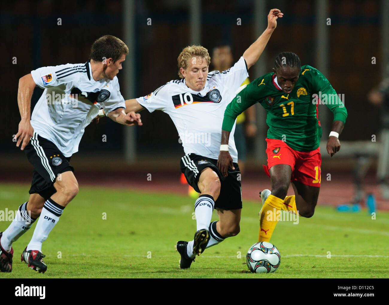 Lewis Holtby of Germany (10) defends against Germain Tiko of Cameroon (17) during the 2009 FIFA U-20 World Cup Group - Stock Image