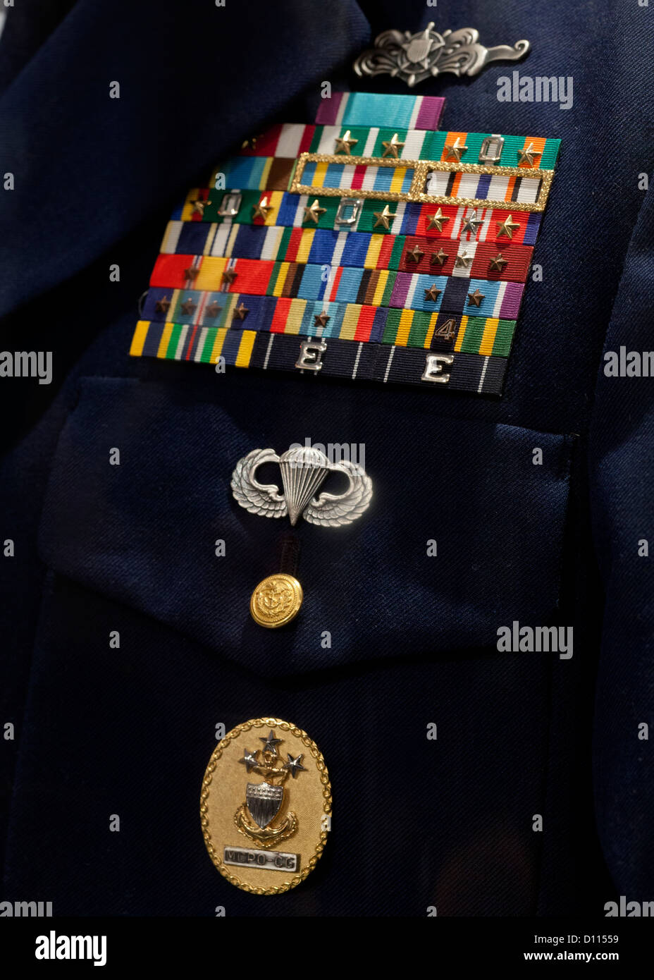 US Coast Guard Service Dress blue uniform with honor ribbons and medals - Stock Image