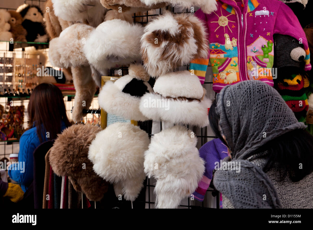 Womens fur hats on rack - Stock Image