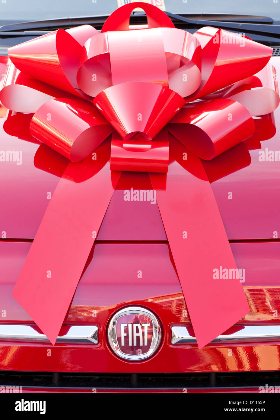 Ribbon on hood of car - Stock Image