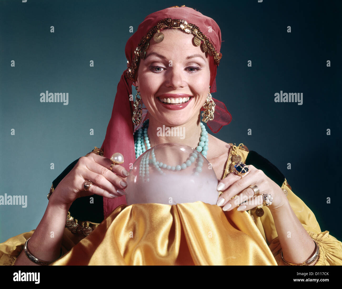1960s WOMAN PORTRAIT CHARACTER CRYSTAL BALL FORTUNE TELLER COSTUME - Stock Image