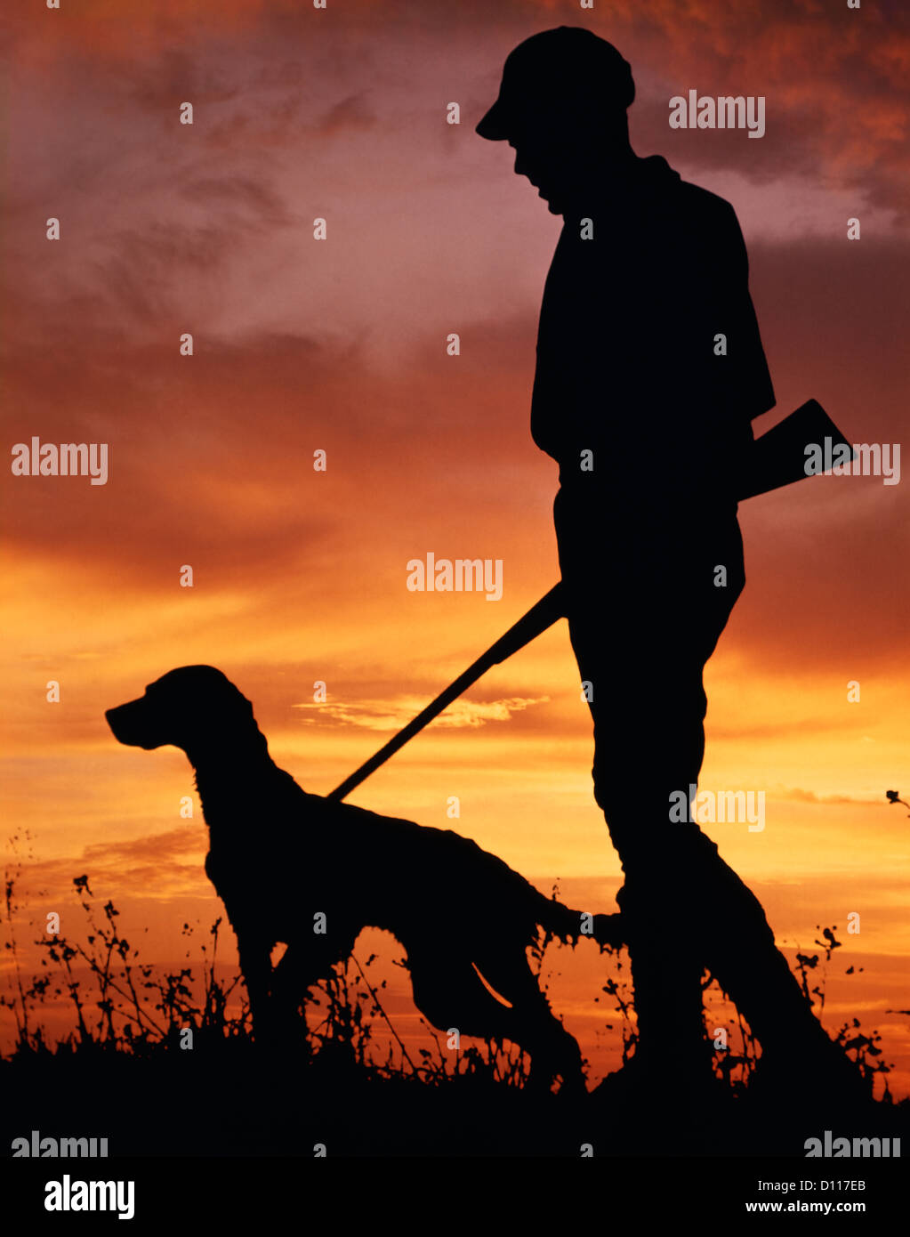 0e5078a0c4189 1960s SILHOUETTE OF MAN HUNTER WITH SHOTGUN AND ENGLISH SETTER DOG IN SUNSET