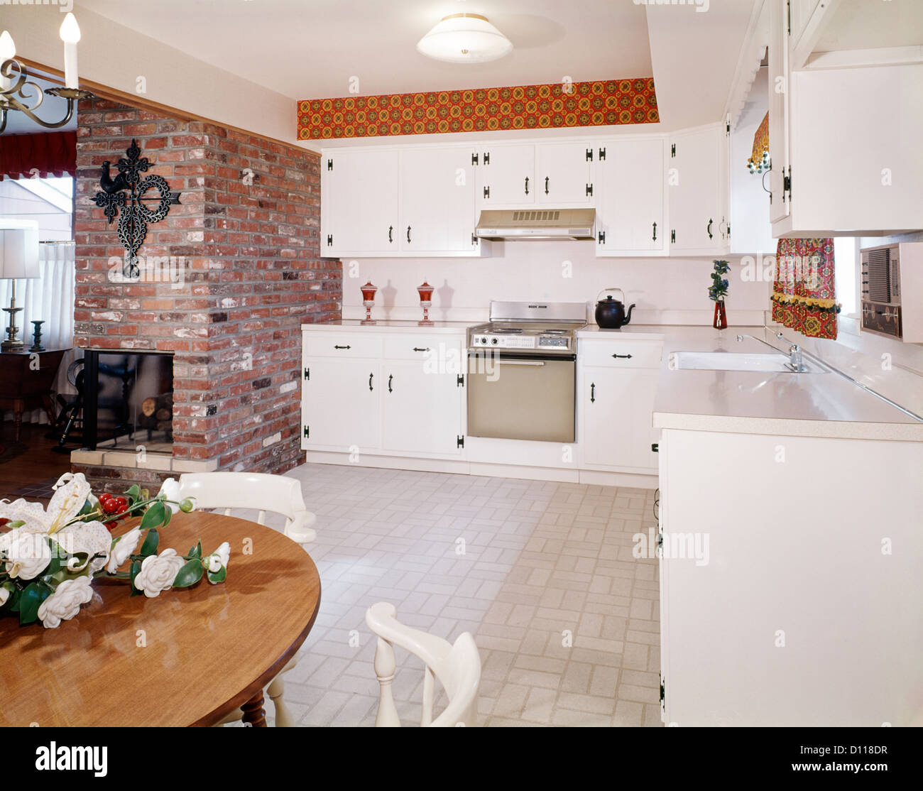 Kitchen Interior With Pink Furniture And Tiles Stock: 1960s KITCHEN INTERIOR WITH BRICK WALL AND WHITE COUNTRY