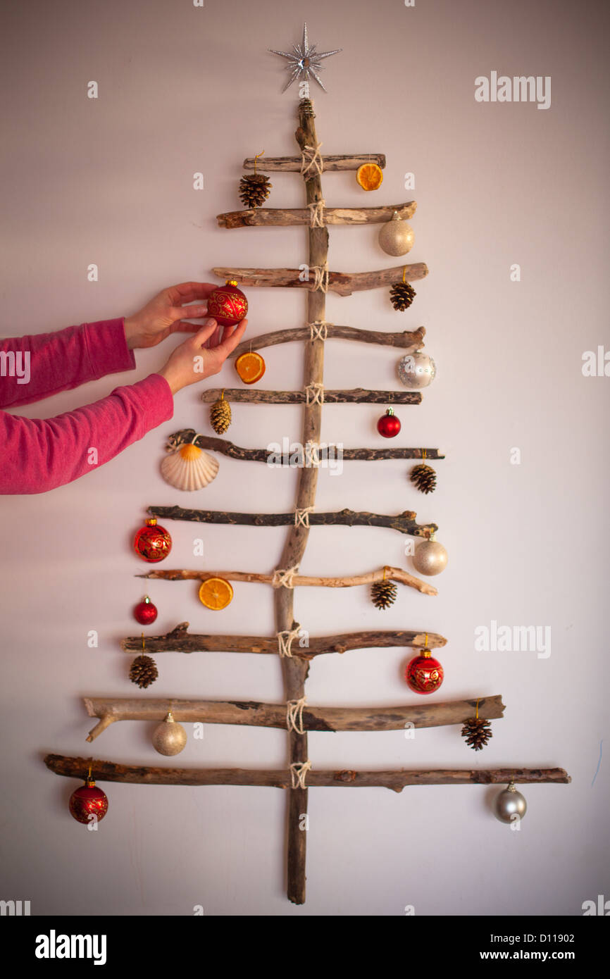 Driftwood Christmas tree made form pieces of driftwood found on the beach and string. - Stock Image