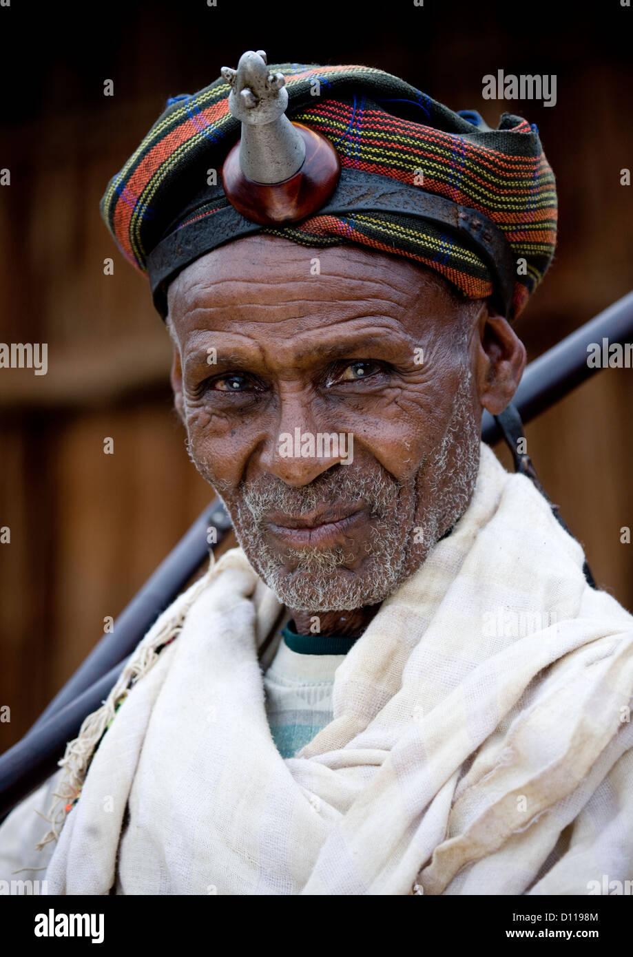 Portrait Of A Smiling Borana Tribe Chief Wearing The Kalasha On His Forehead, Yabello, Omo Valley, Ethiopia - Stock Image