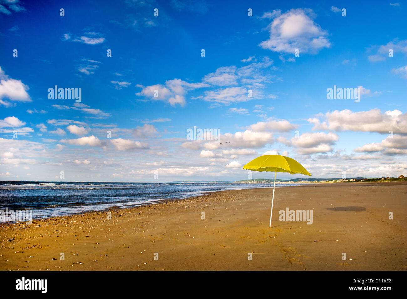 Normandy coast with yellow parasol - Stock Image