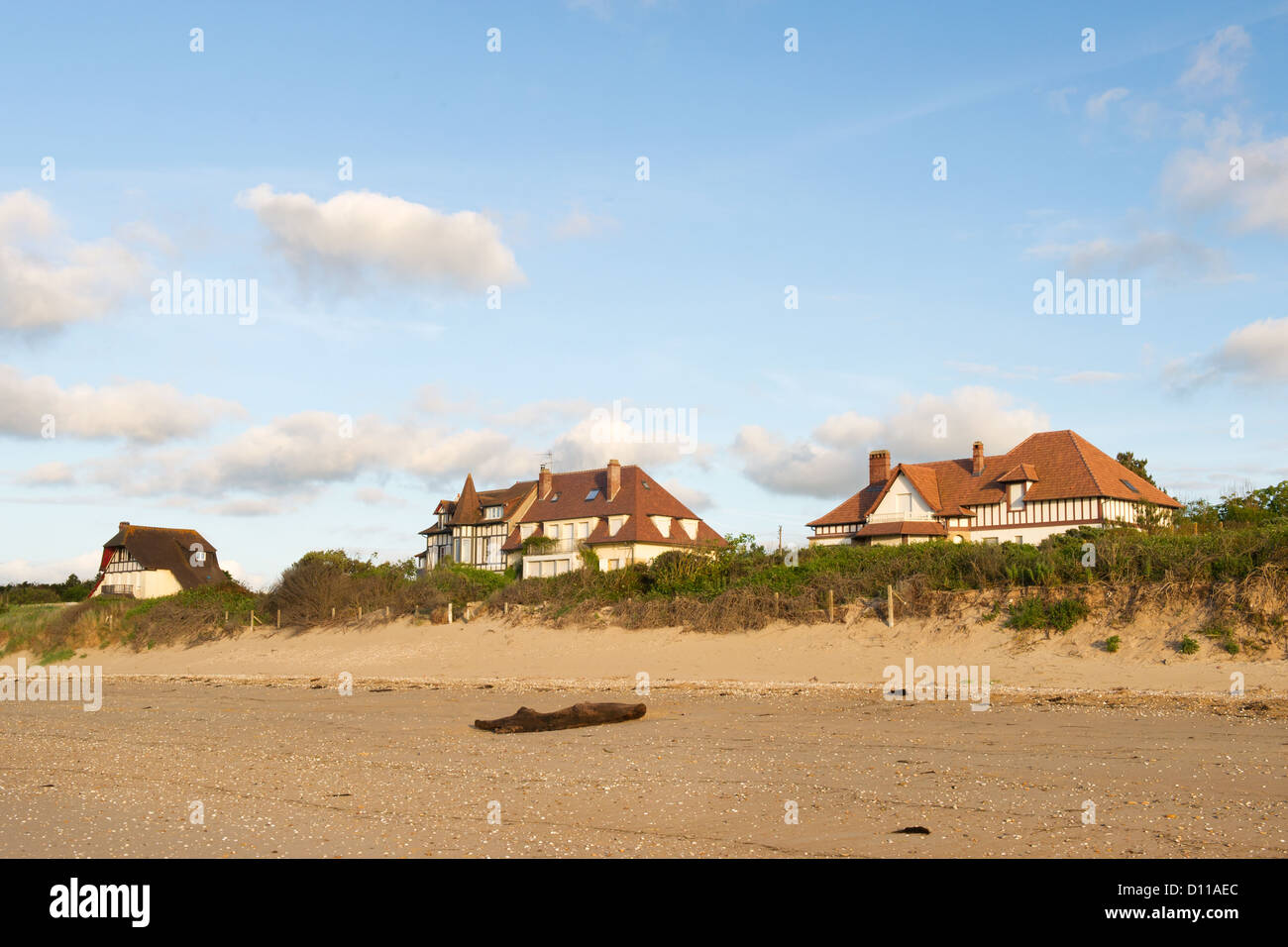 typical Normandy houses at the coat from Merville Franceville - Stock Image