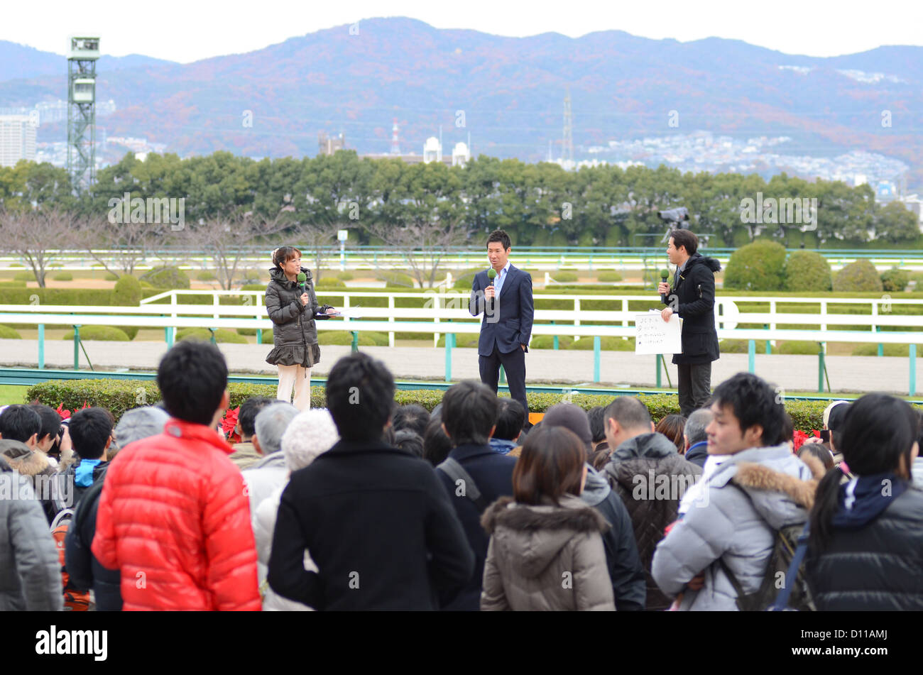 Japanese racing driver Kamui Kobayashi speaks during a special appearance at Hanshin racecourse in Japan on 2nd - Stock Image