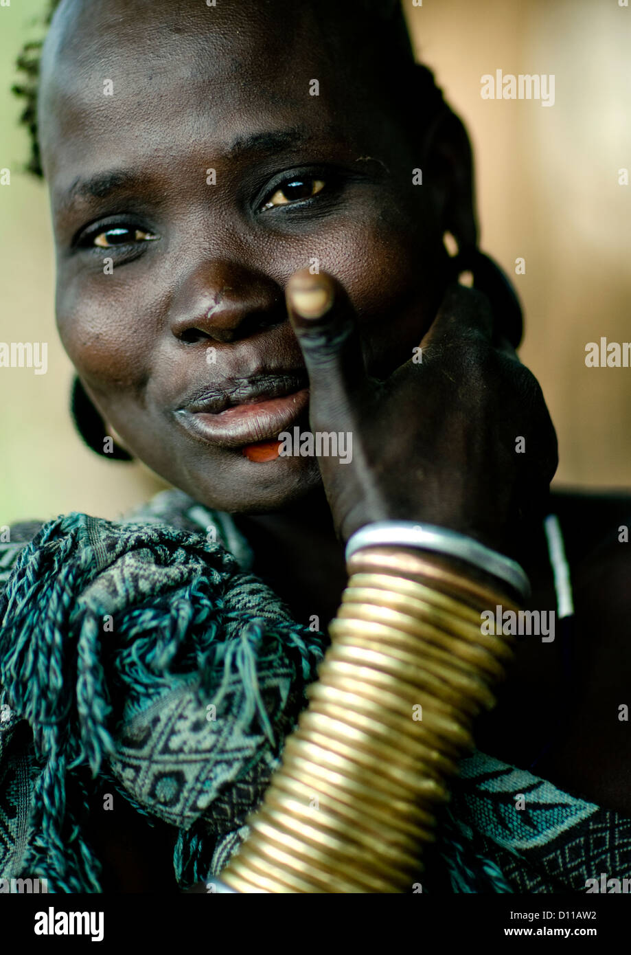 Portrait Of A Smiling Bodi Tribe Woman With Copper Bracelets, Hana Mursi, Omo Valley, Ethiopia - Stock Image