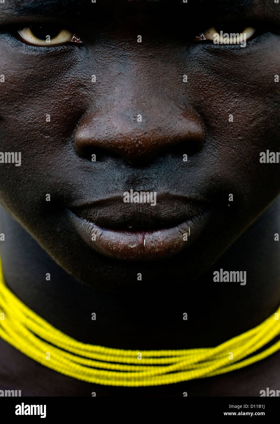 Close Up On The Face Of A Mursi Tribe Man With Yellow Necklace, Omo Valley, Ethiopia - Stock Image