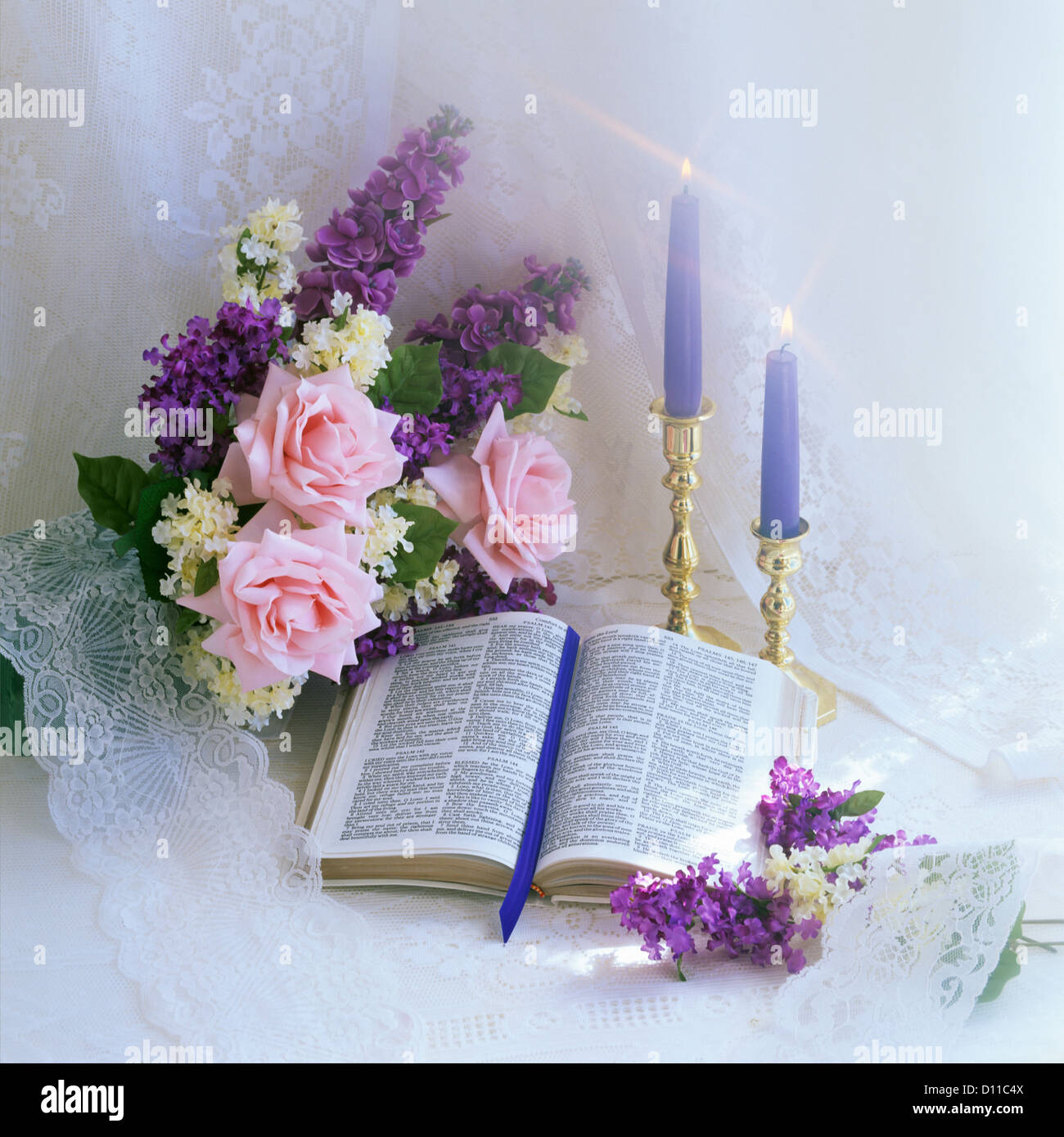 Open bible blue candles and bouquet of pink and purple flowers stock open bible blue candles and bouquet of pink and purple flowers izmirmasajfo