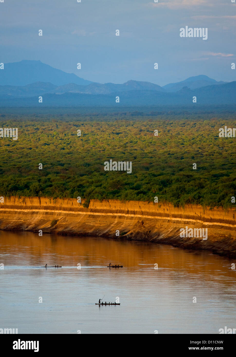 Boats Crossing Omo River With Mountains In The Background, Omo Valley, Ethiopia Stock Photo