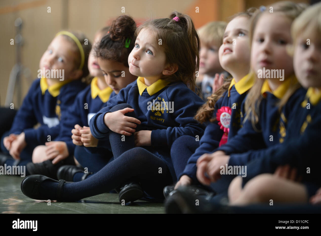 Children in morning assembly at Our Lady & St. Werburgh's Catholic Primary School in Newcastle-under-Lyme, - Stock Image