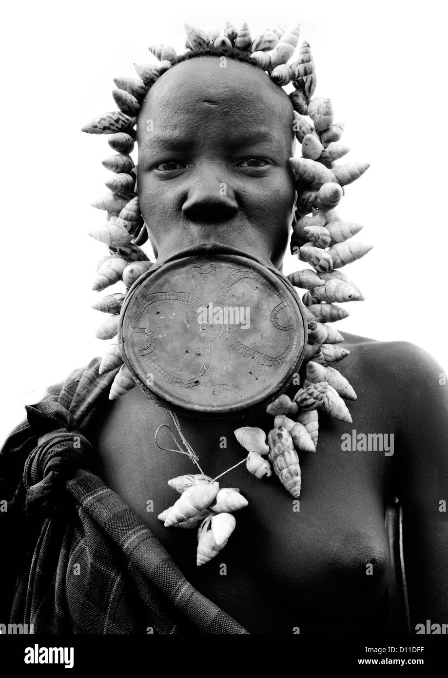 Black And White Portrait Of A Mursi Tribe Woman With Lip Plate And Enlarged Ears In Mago National Park, Omo Valley, - Stock Image