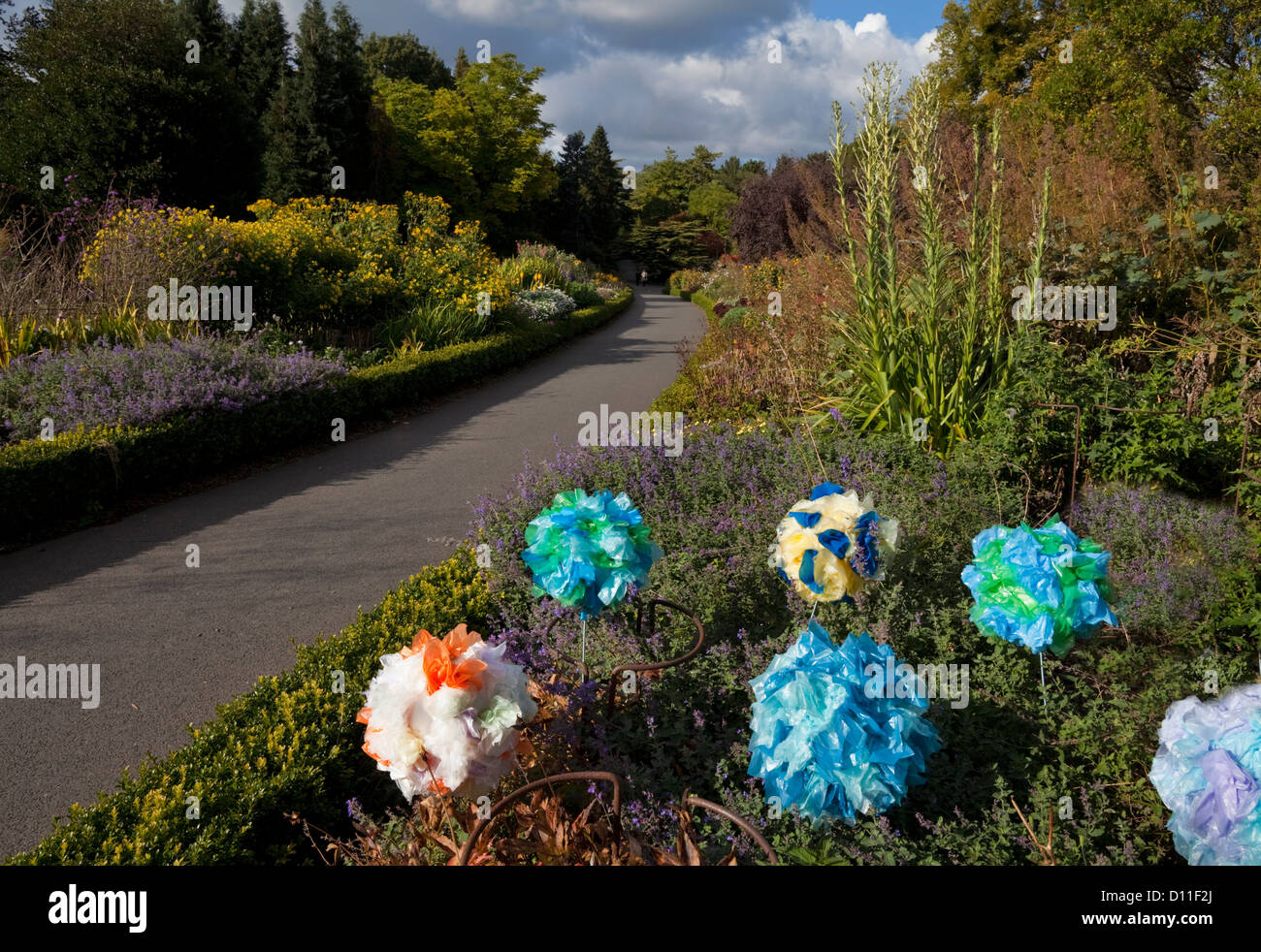 Plastic Flower Sculptures in one of the twin perennial borders, The National Botanic Gardens (1795), Dublin City, - Stock Image