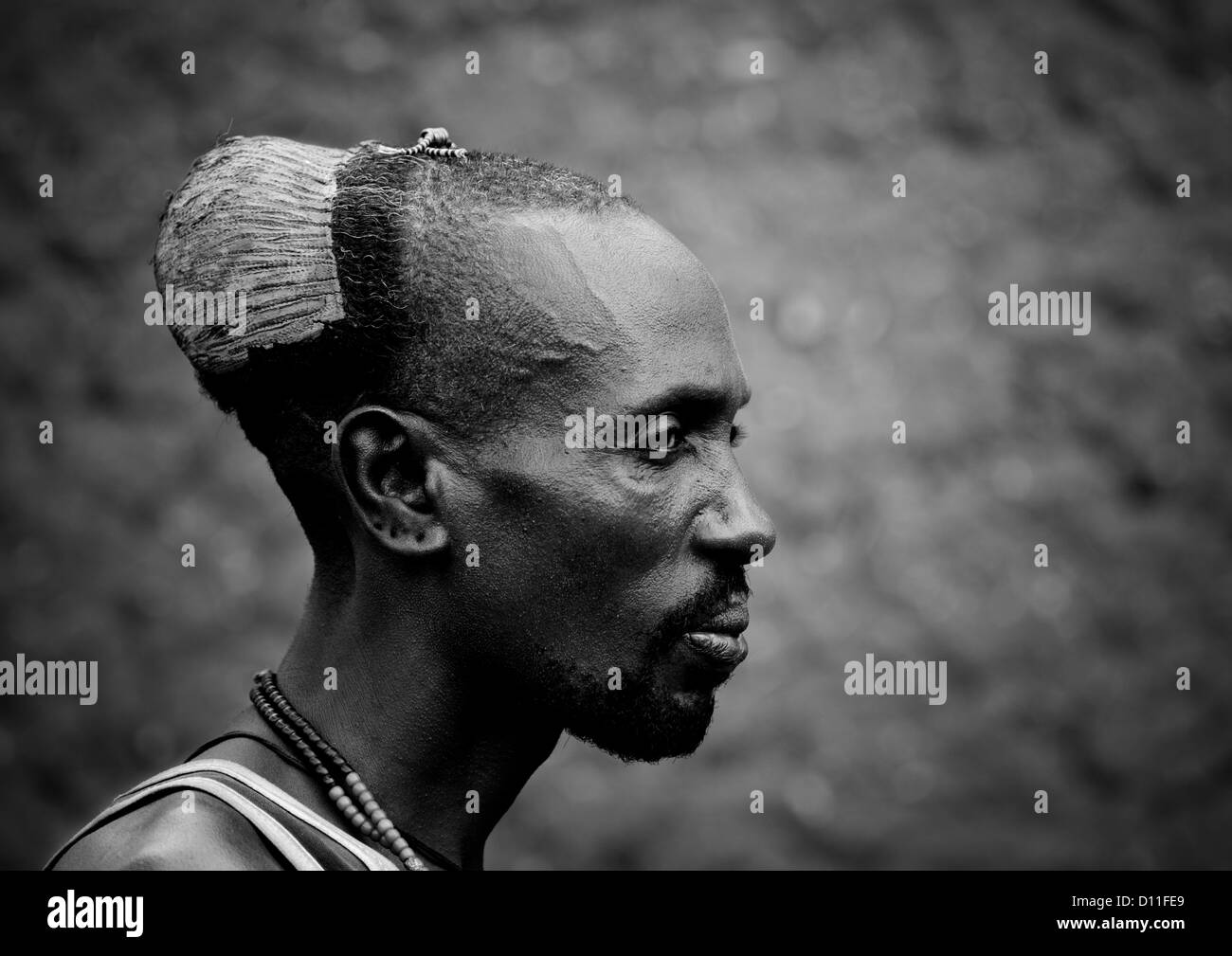 black and white profile portrait of hamar tribe man with
