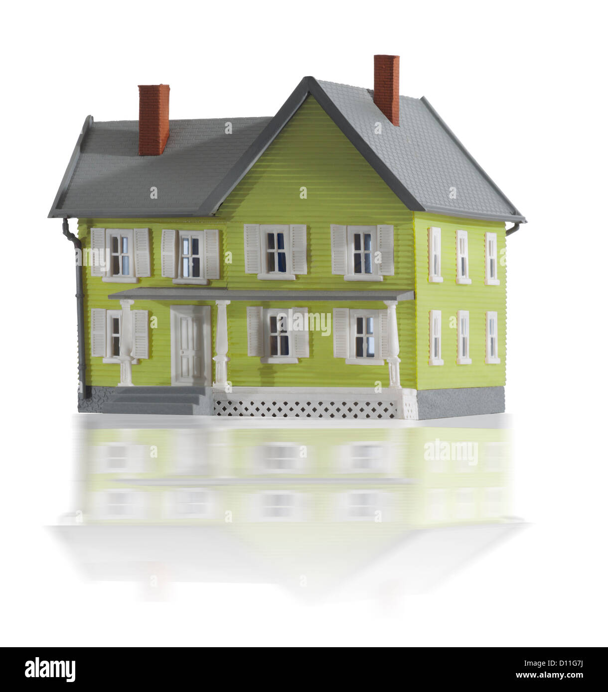 Gray and green miniature farm house - Stock Image