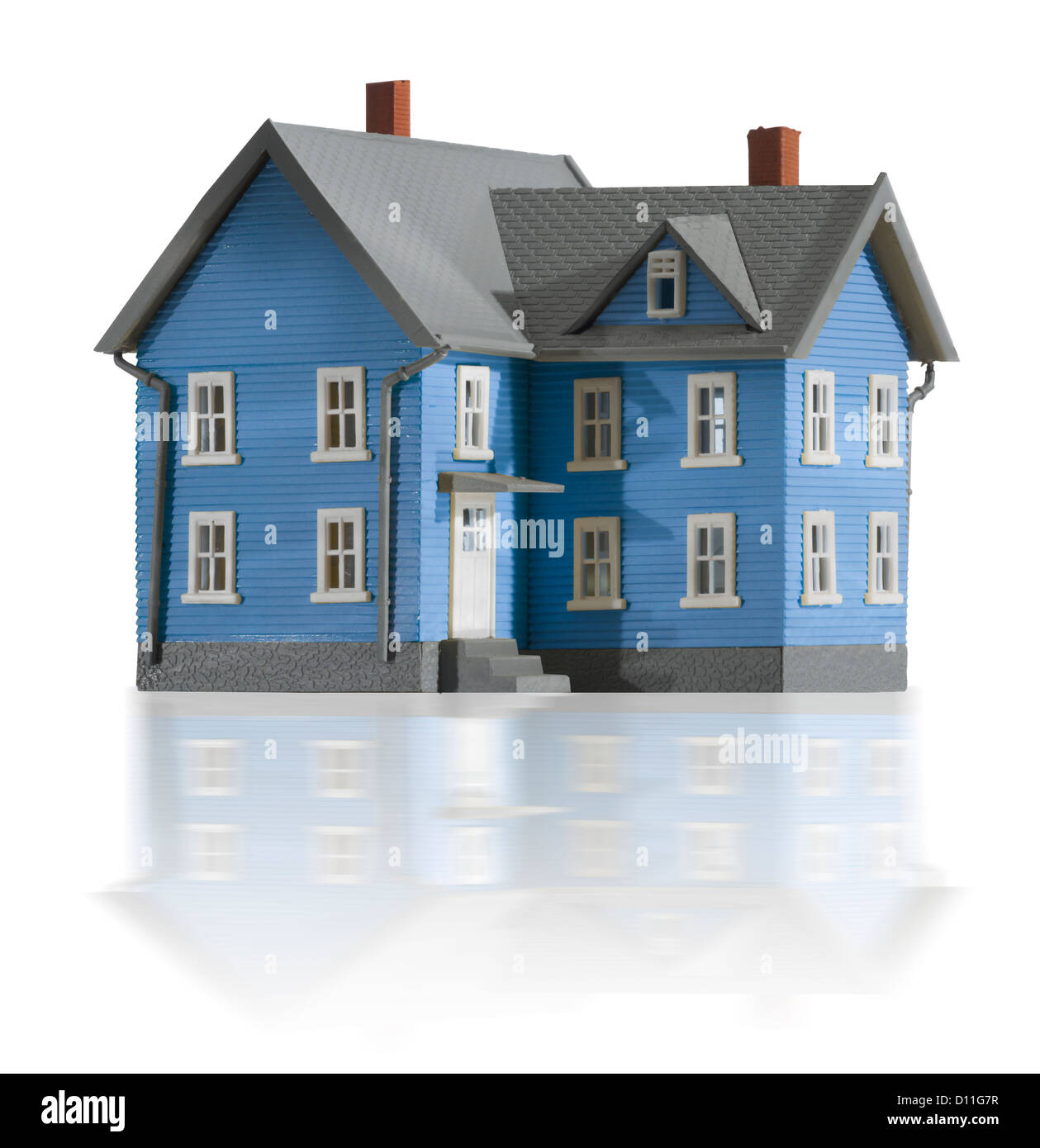 Gray and blue miniature farm house - Stock Image