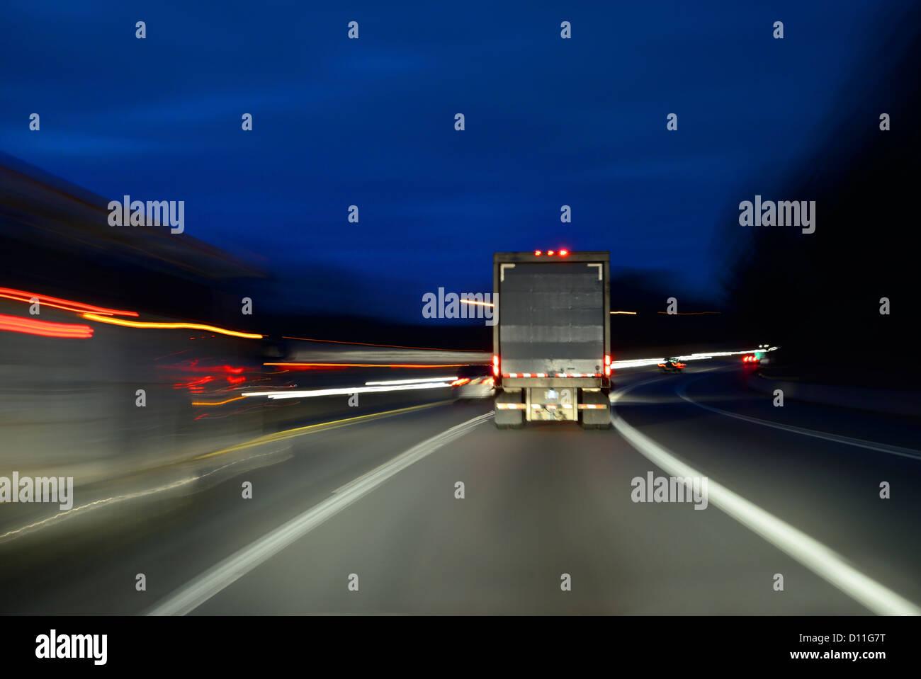 Truck Lorry Speeding On Highway At Night, USA - Stock Image
