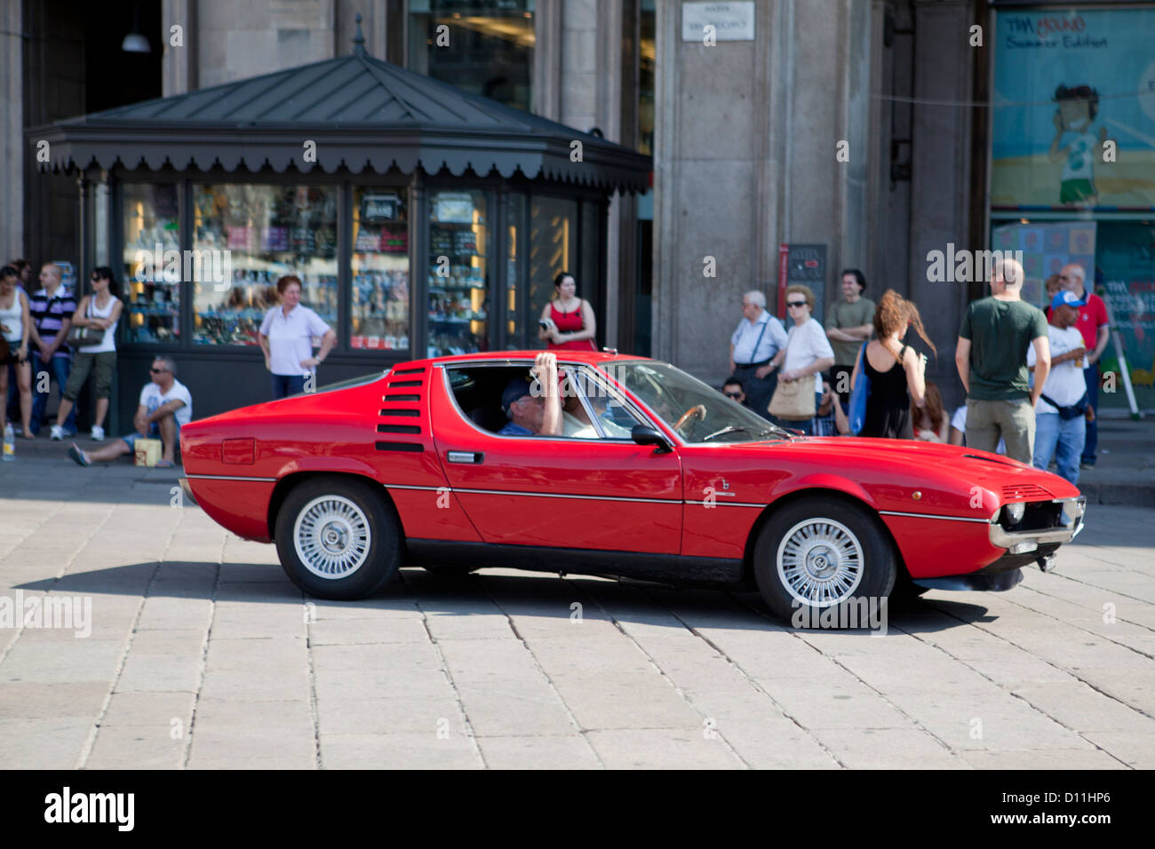 Piazza del Duomo, Milano. Defile of old famous sport cars, here an ...