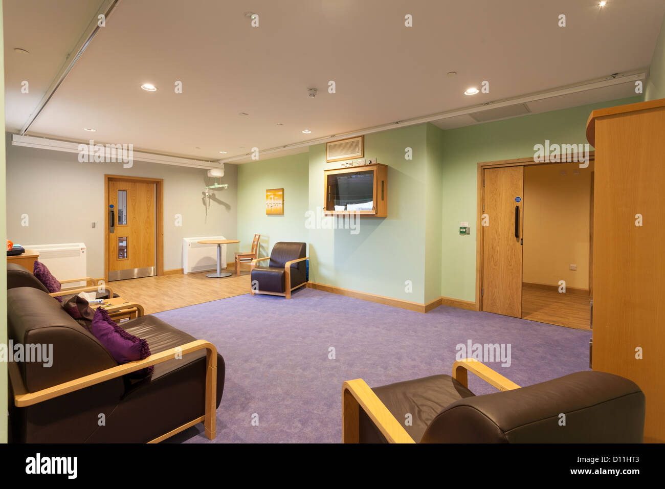 care home, challenging behaviour residents lounge with ceiling track hoist lifting and polycarbonate screen protected - Stock Image
