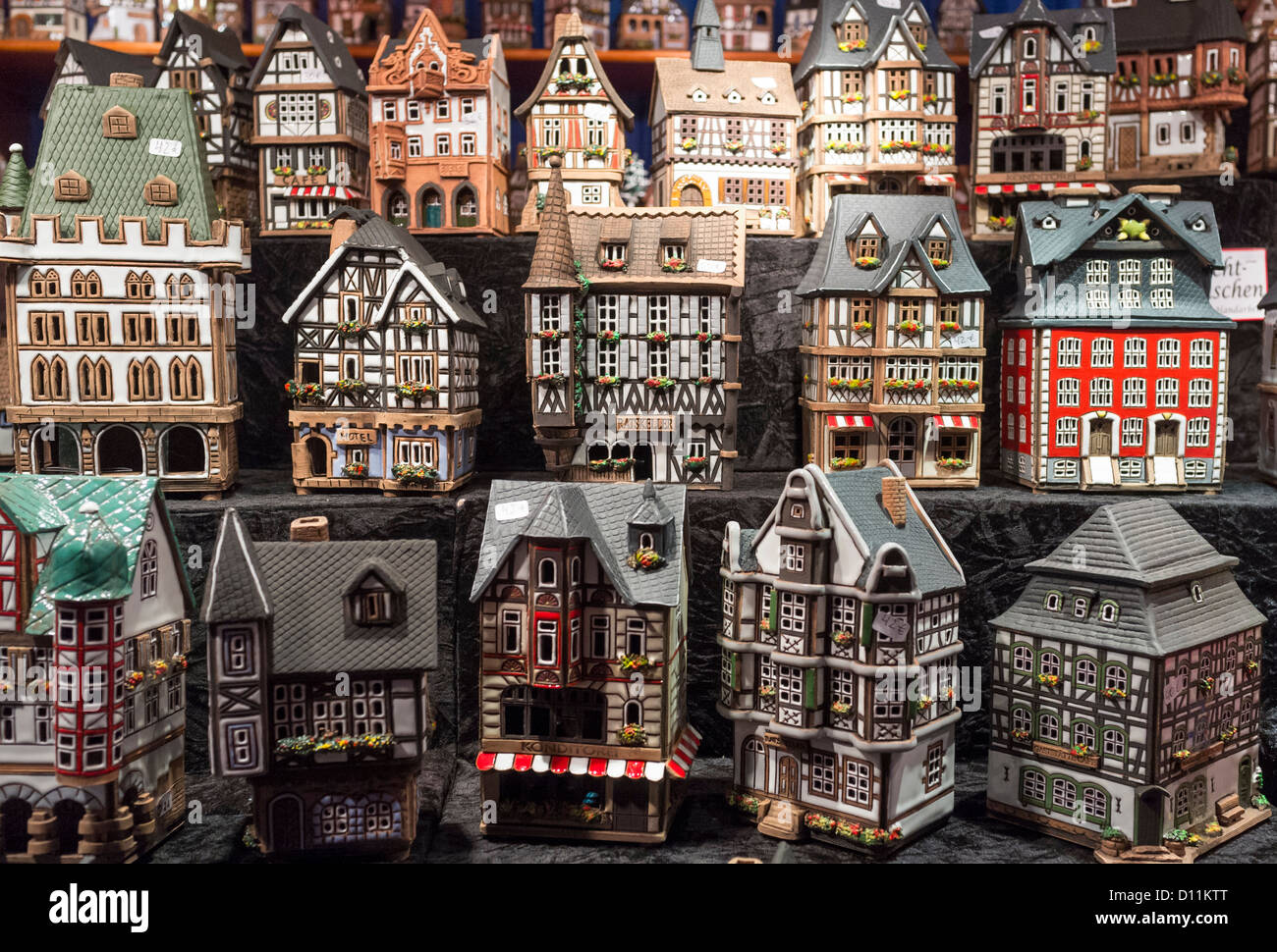 Traditional lanterns in shape of old model houses for sale on craft stall in Cologne Christmas Market in Germany - Stock Image