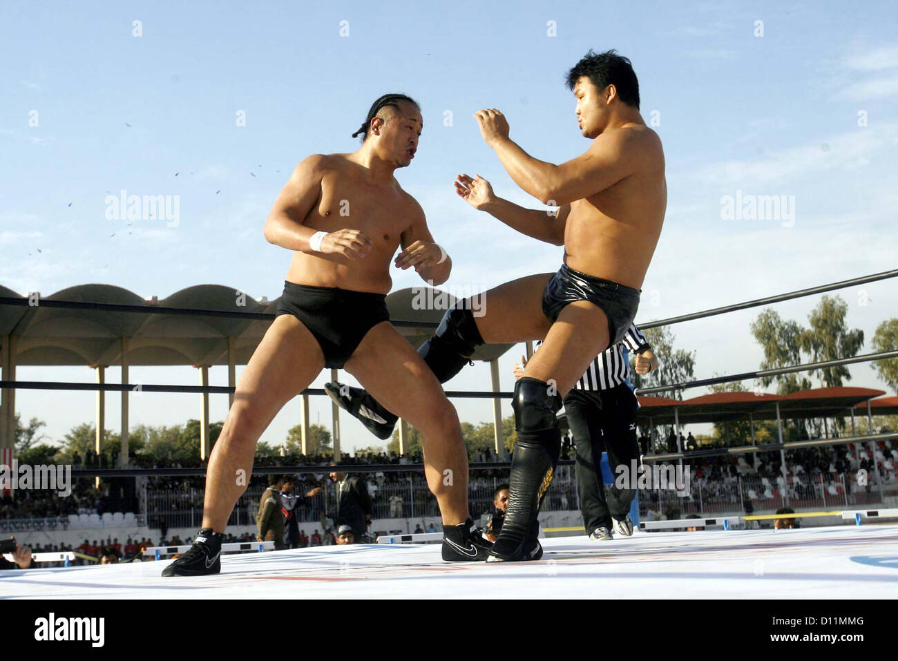 "Japanese wrestlers in action during ""Wrestling for Peace  Festival 2012"" held at Qayyum Stadium in Peshawar on Wednesday, Stock Photo"