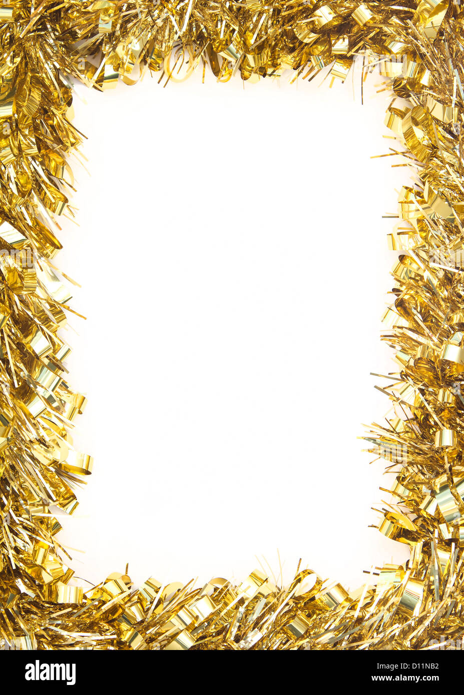 Gold Christmas tinsel garland, forming a rectangular border on white background - Stock Image