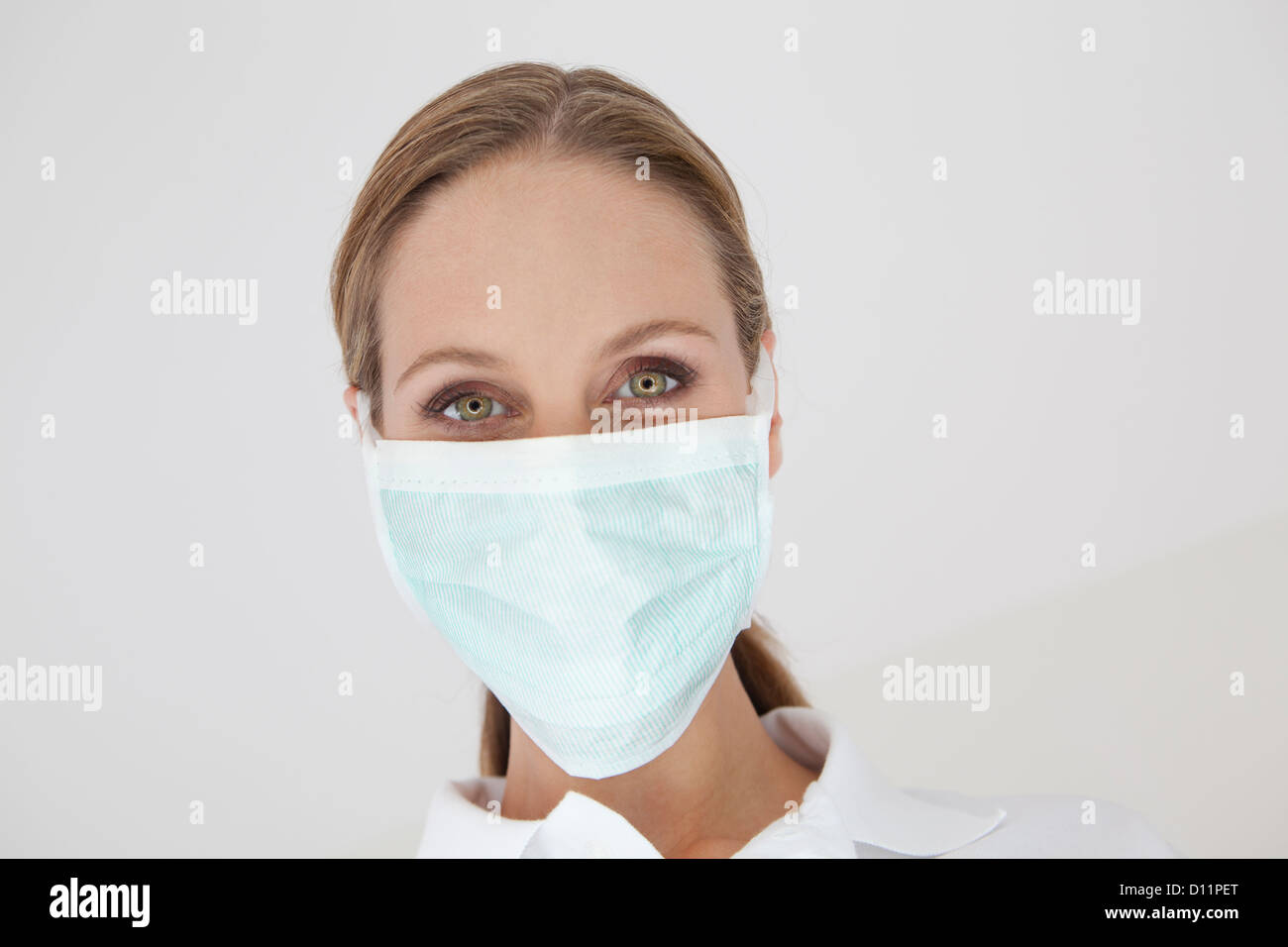 Germany, Close up of dentist with surgical mask - Stock Image