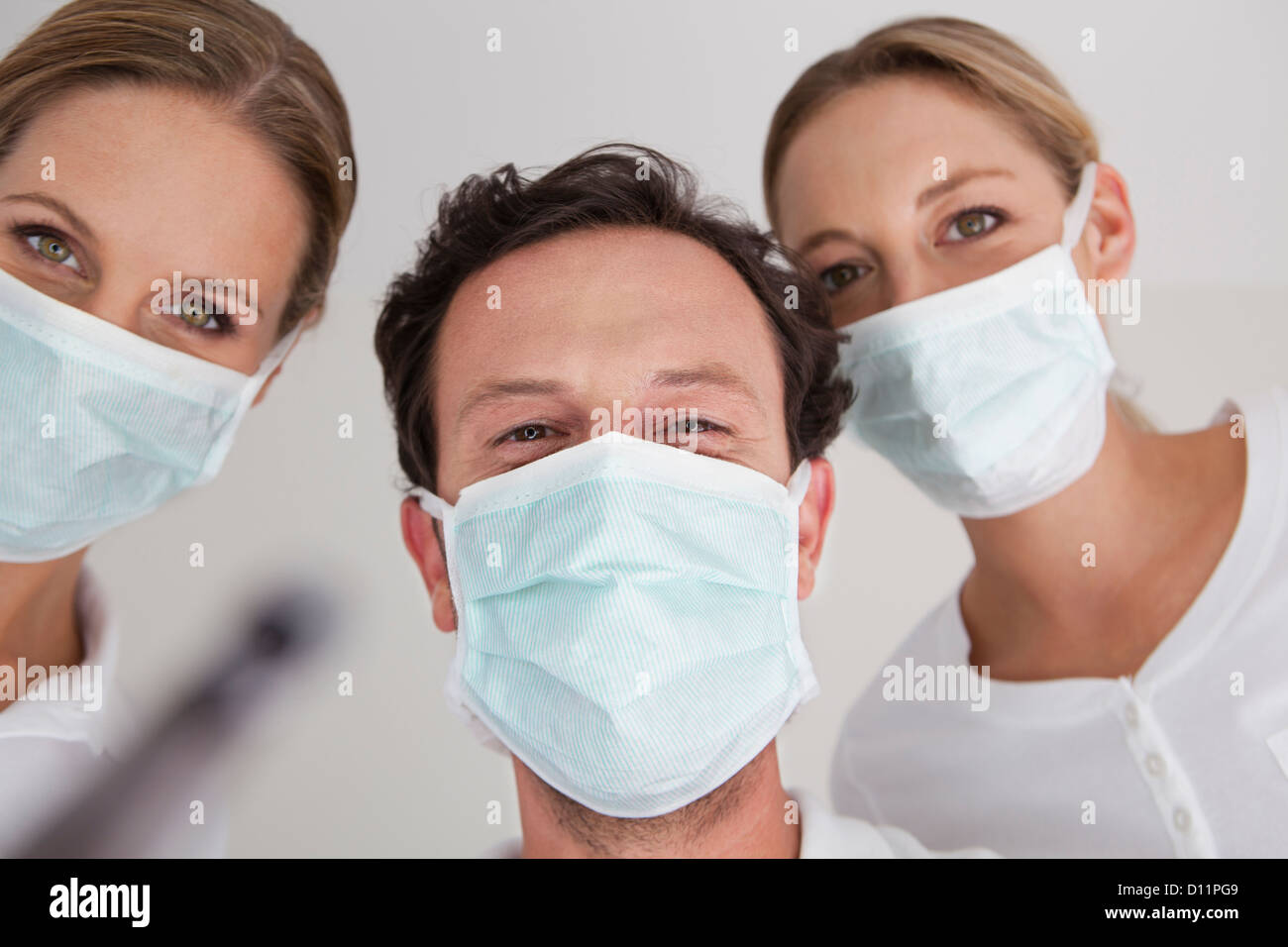 Germany, Dentist with surgical mask, portrait - Stock Image