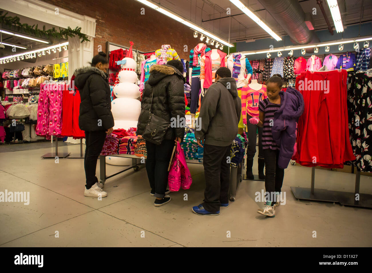 Shopping in an Old Navy store in the New York neighborhood of Soho ...