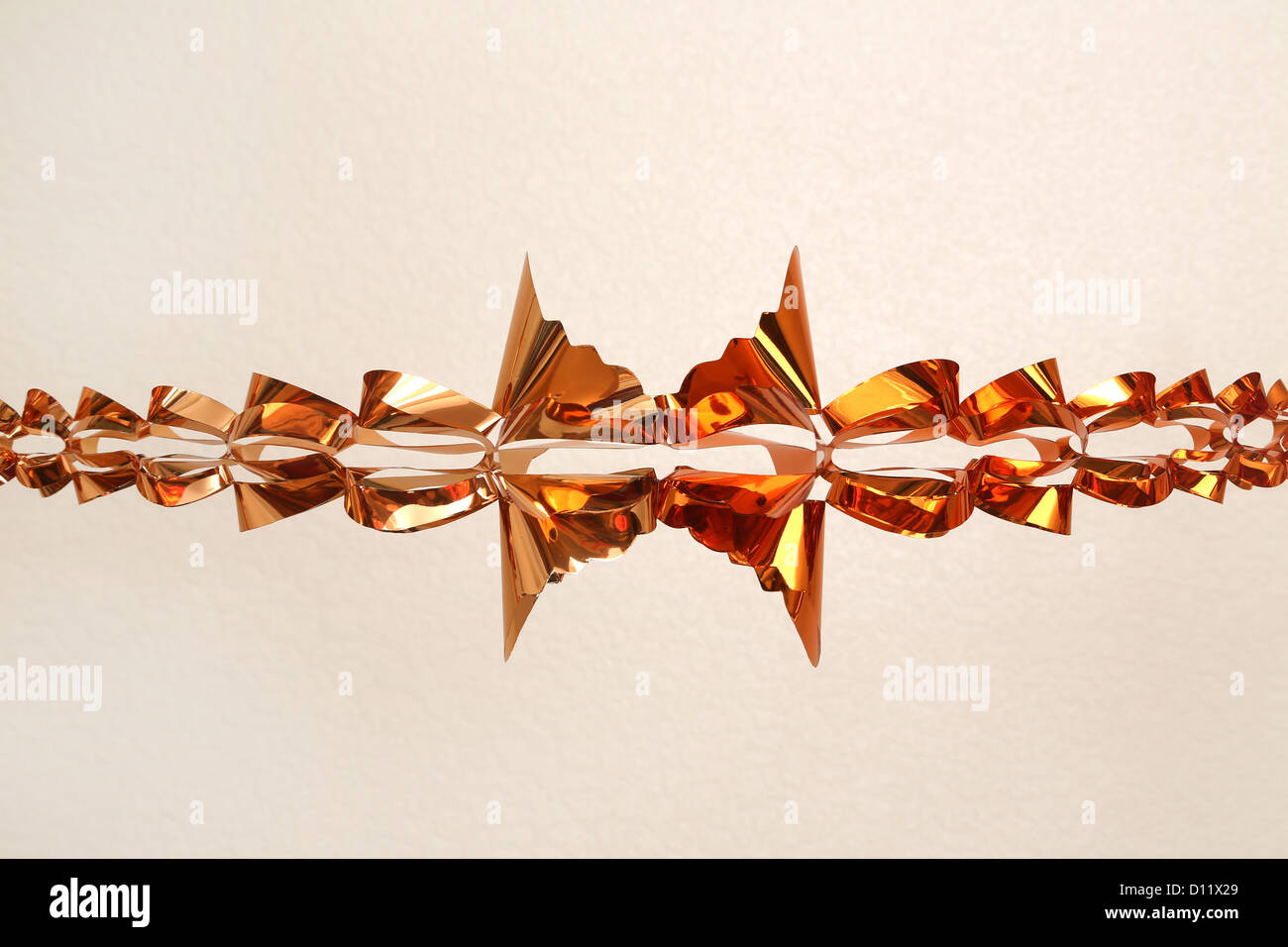 Copper Coloured Christmas Garland Decoration - Stock Image
