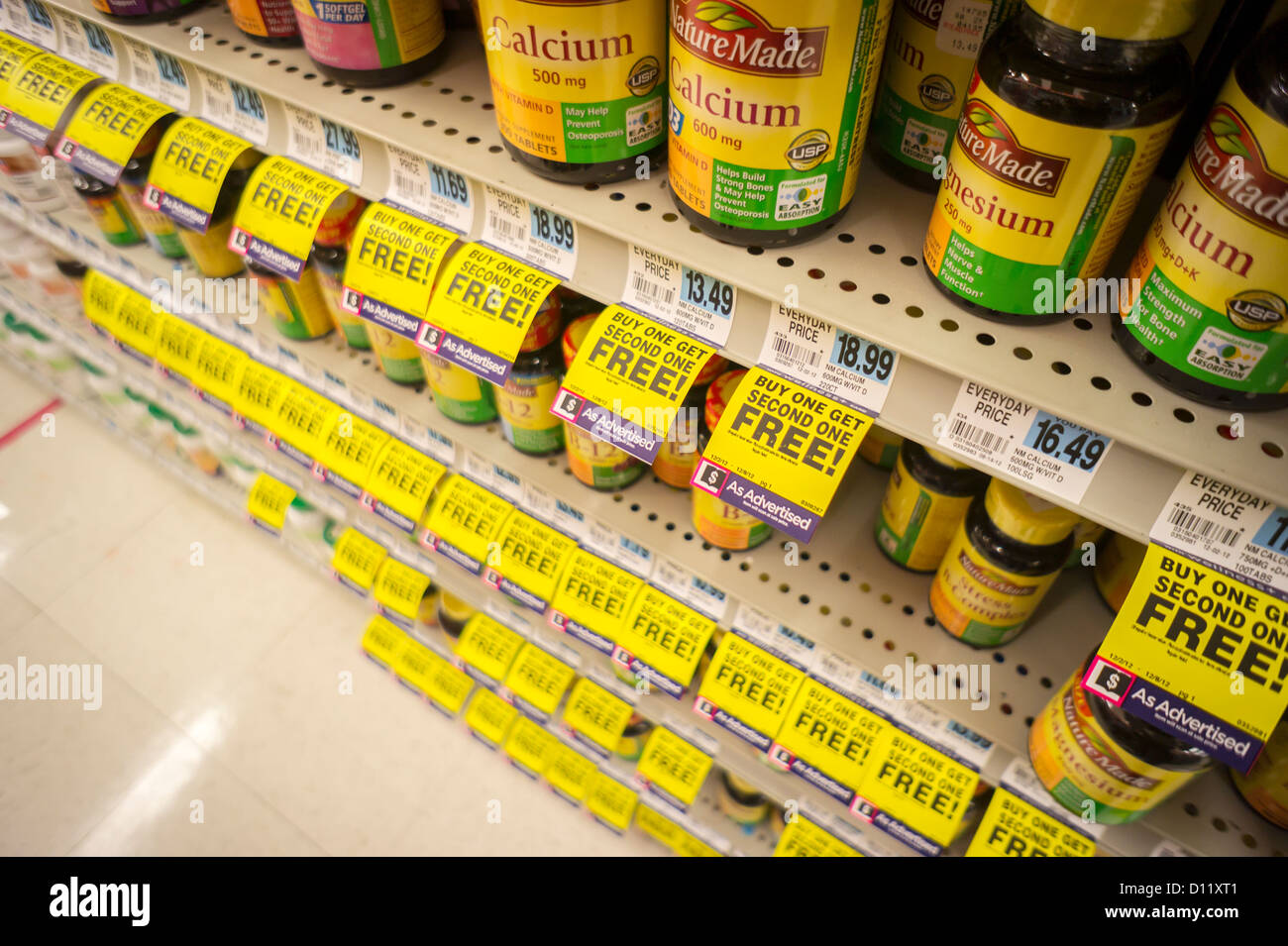 Vitamins and other supplements are seen on the shelves of a drugstore in New York - Stock Image