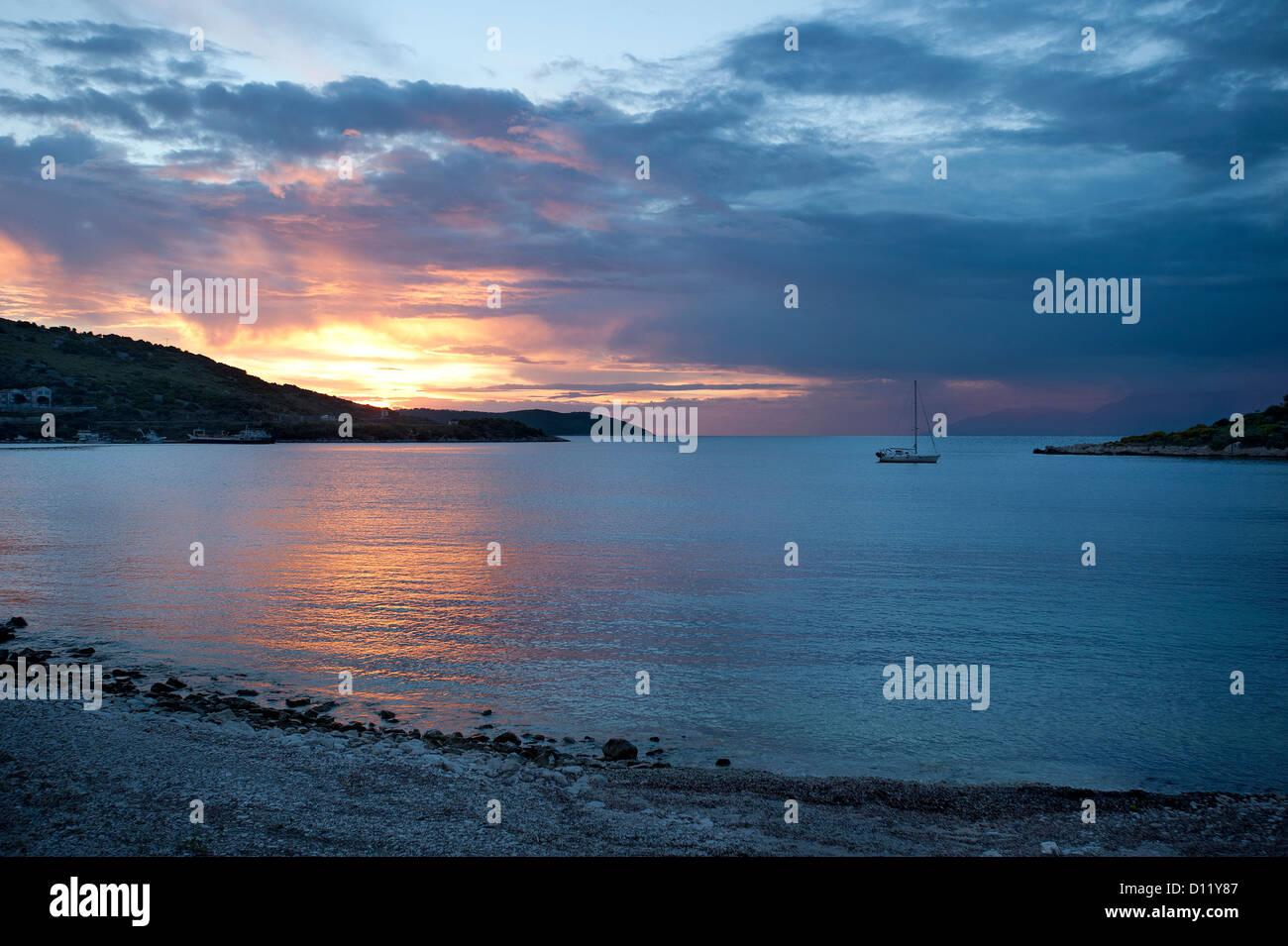 Sunset at Kassiopi Beach, Corfu, Ionian Islands, Greece - Stock Image