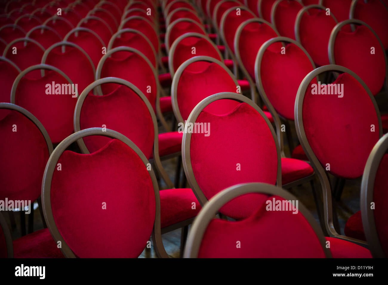 Rows Of Empty Plush Red Velvet Chairs In A Conference Hall   Stock Image