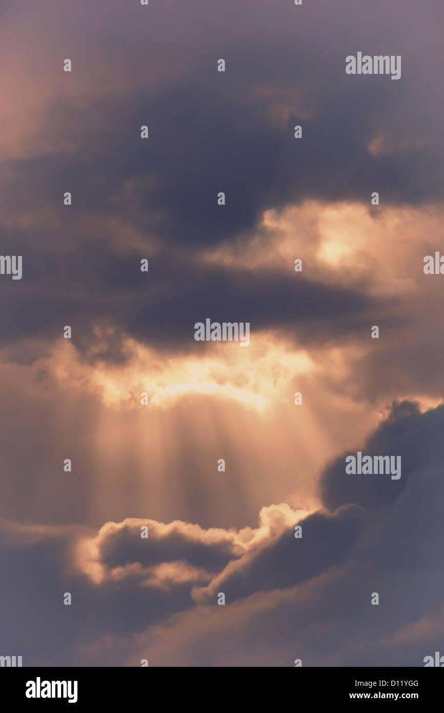 Sun Rays Bursting Through Storm Clouds; Spain Stock Photo