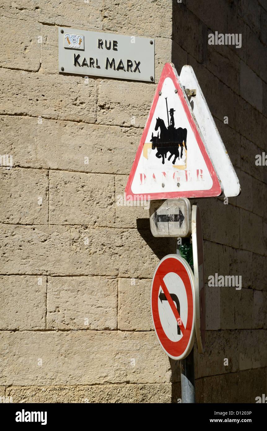 Funny Sign Rue Karl Marx No Left Turn Danger Sign Marsillargues Hérault France - Stock Image