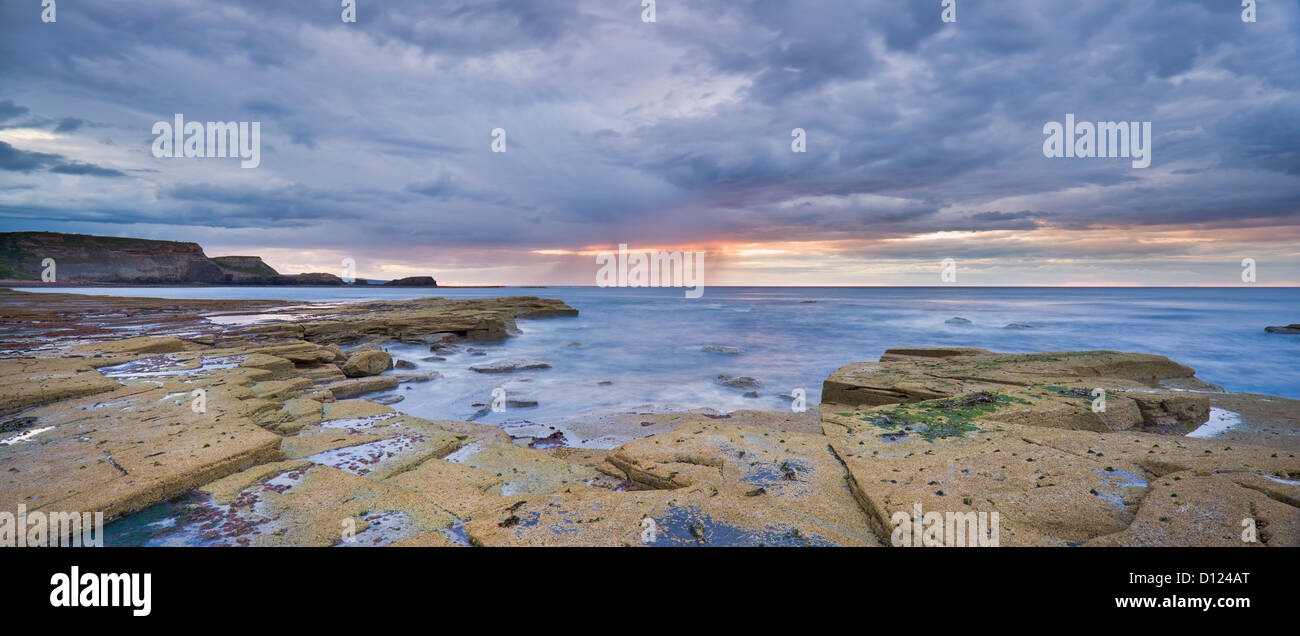 A Showery Evening At Low Tide In Saltwick Bay; Saltwick Bay North Yorkshire England Stock Photo