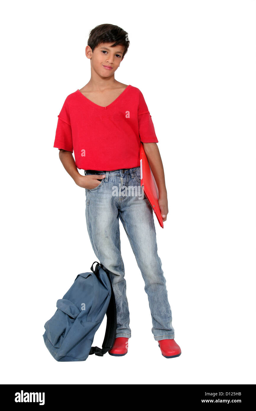 Young schoolboy in a red t-shirt and shoes - Stock Image