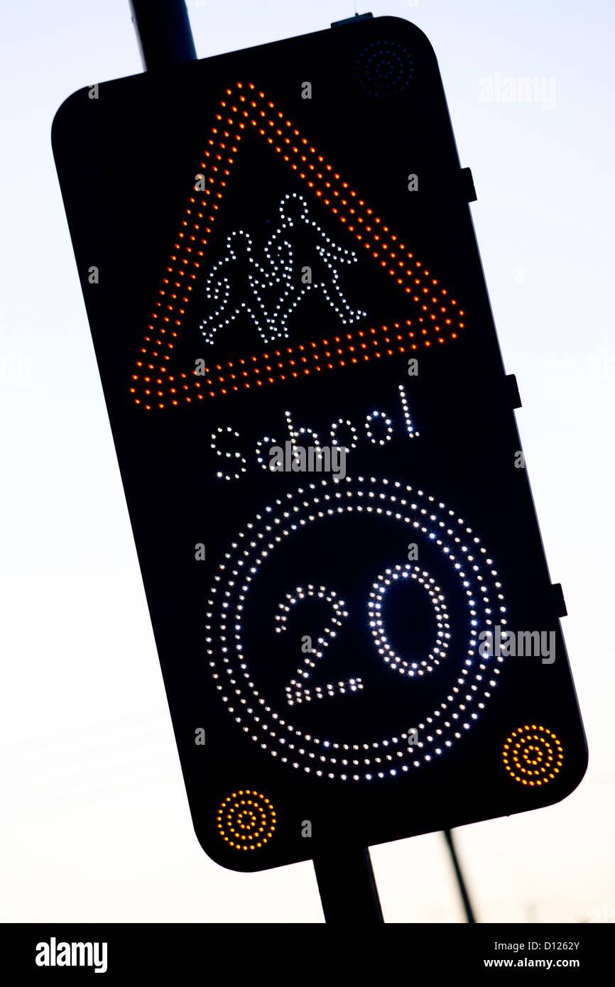 20 mile per hour 20 mph warning school flashing school sign UK - Stock Image