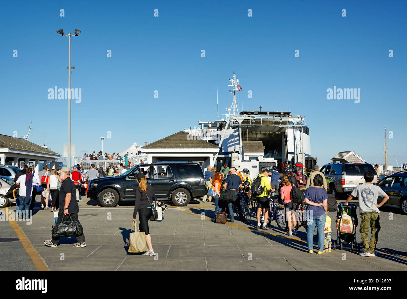 Passengers boarding ferry from Vineyard Haven for Woods Hole, Martha's Vineyard, Massachusetts, USA - Stock Image