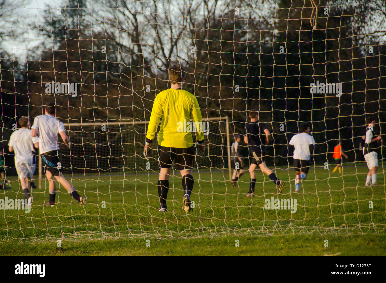 Football game, Goal, goalkeeper and players, The Downs, Bristol, UK - Stock Image