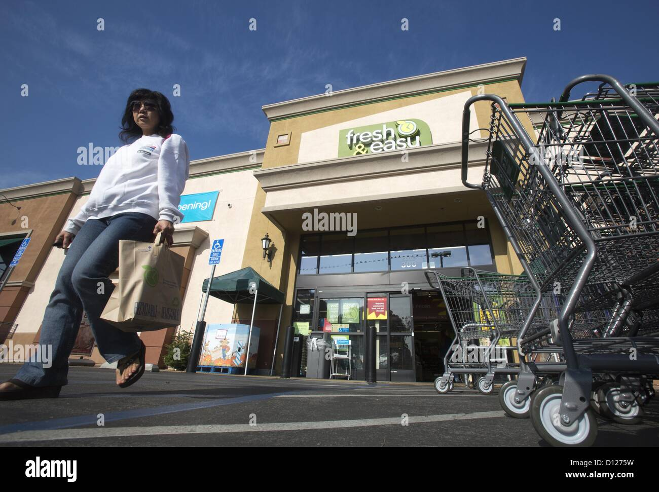 Dec. 5, 2012 - Los Angeles, California (CA, United States - A customer leaves a Fresh & Easy supermarket on - Stock Image
