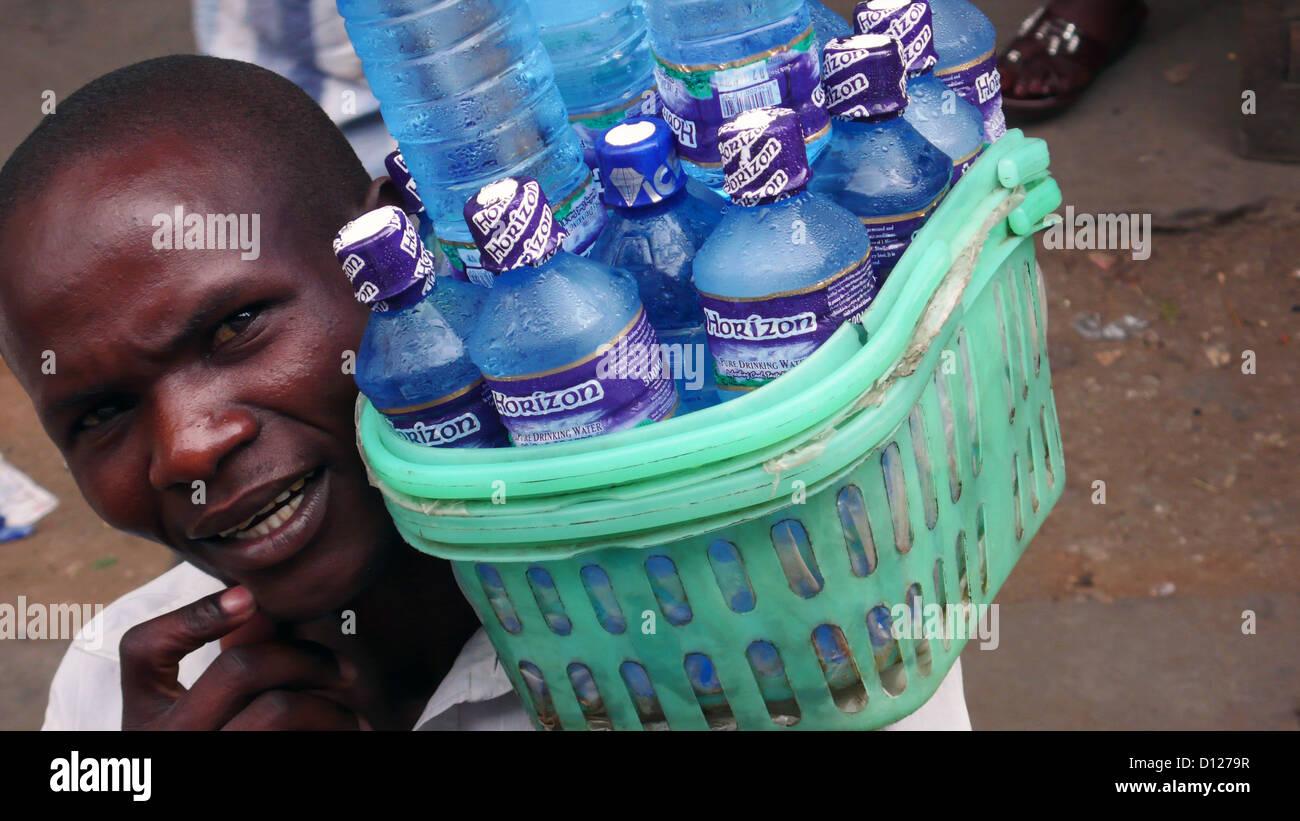 Man selling bottled water, Kenya, East Africa. - Stock Image