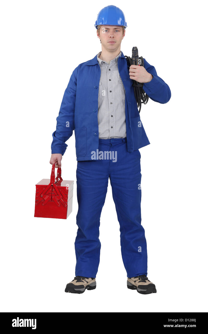 Electrician carrying cable and tool box - Stock Image