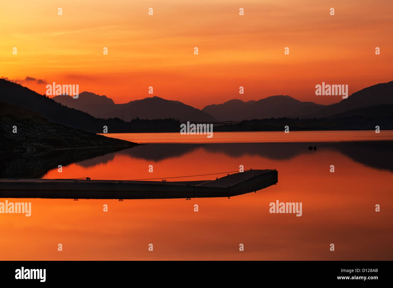 Loch Leven in highlands of Scotland near Glencoe. A beutiful sunset with a pier in the foreground and Scottish mountains - Stock Image