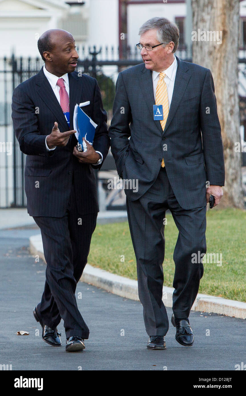Merck President and CEO Ken Frazier and Douglas Oberhelman, CEO of Caterpillar arrive at the White House. - Stock Image