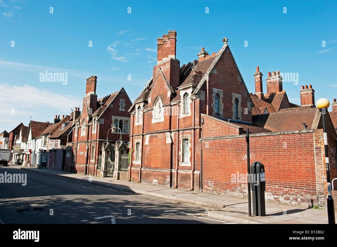 Brick Buildings With Chimneys Along A Street; Salisbury England Stock Photo