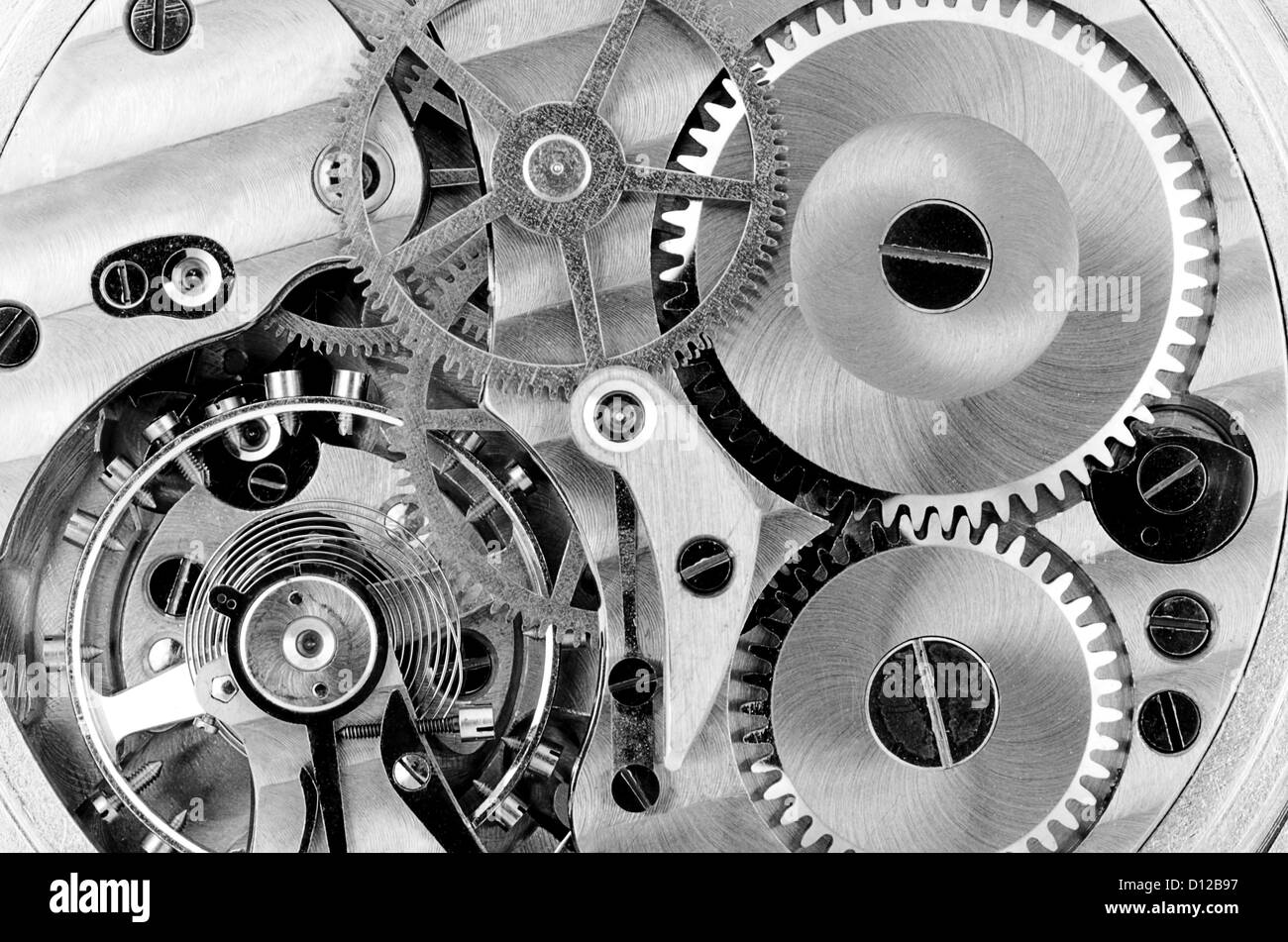 internal mechanism of a watch: gears, cogs, wheels, spring, screws - Stock Image